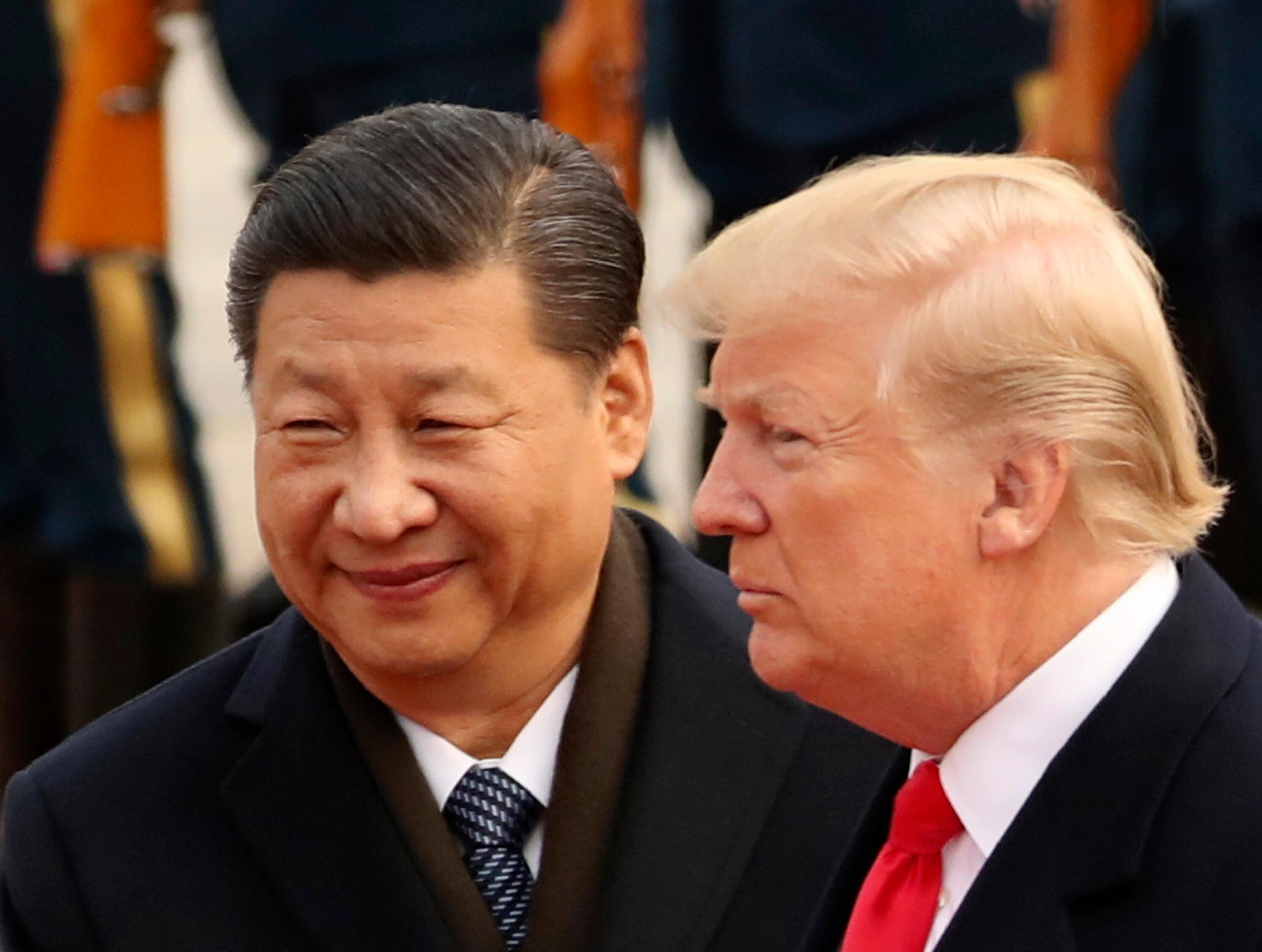 "FILE - In this Nov. 9, 2017, file photo, U.S. President Donald Trump and Chinese President Xi Jinping participate in a welcome ceremony at the Great Hall of the People in Beijing, China. Xi had an ""extremely positive"" phone conversation with Trump about trade and other issues, the foreign ministry said Friday, Nov. 2, 2018. (AP Photo/Andrew Harnik, File)"