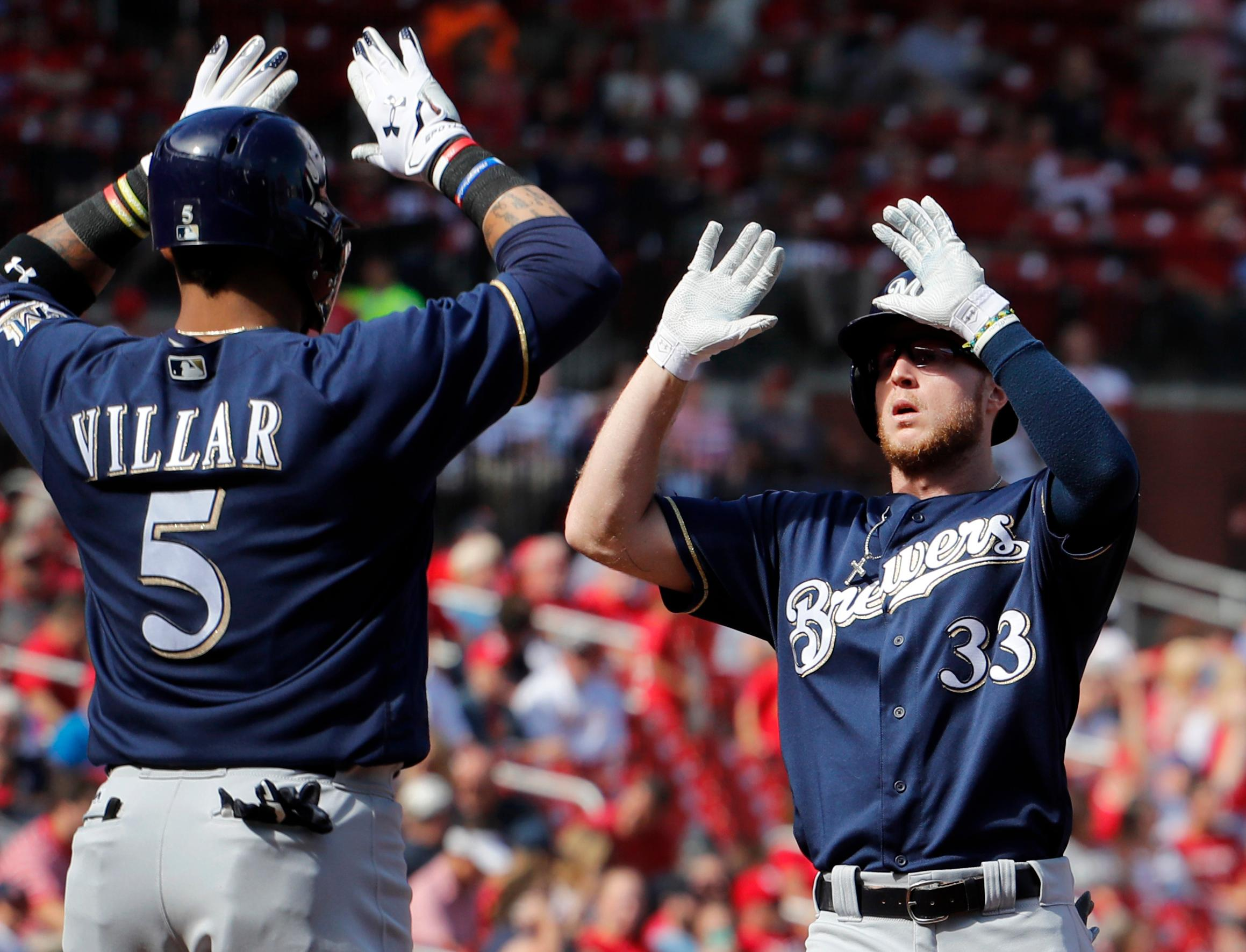 Milwaukee Brewers' Brett Phillips, right, is congratulated by teammate Jonathan Villar after hitting a three-run home run during the first inning against the St. Louis Cardinals, Sunday, Oct. 1, 2017, in St. Louis. (AP Photo/Jeff Roberson)