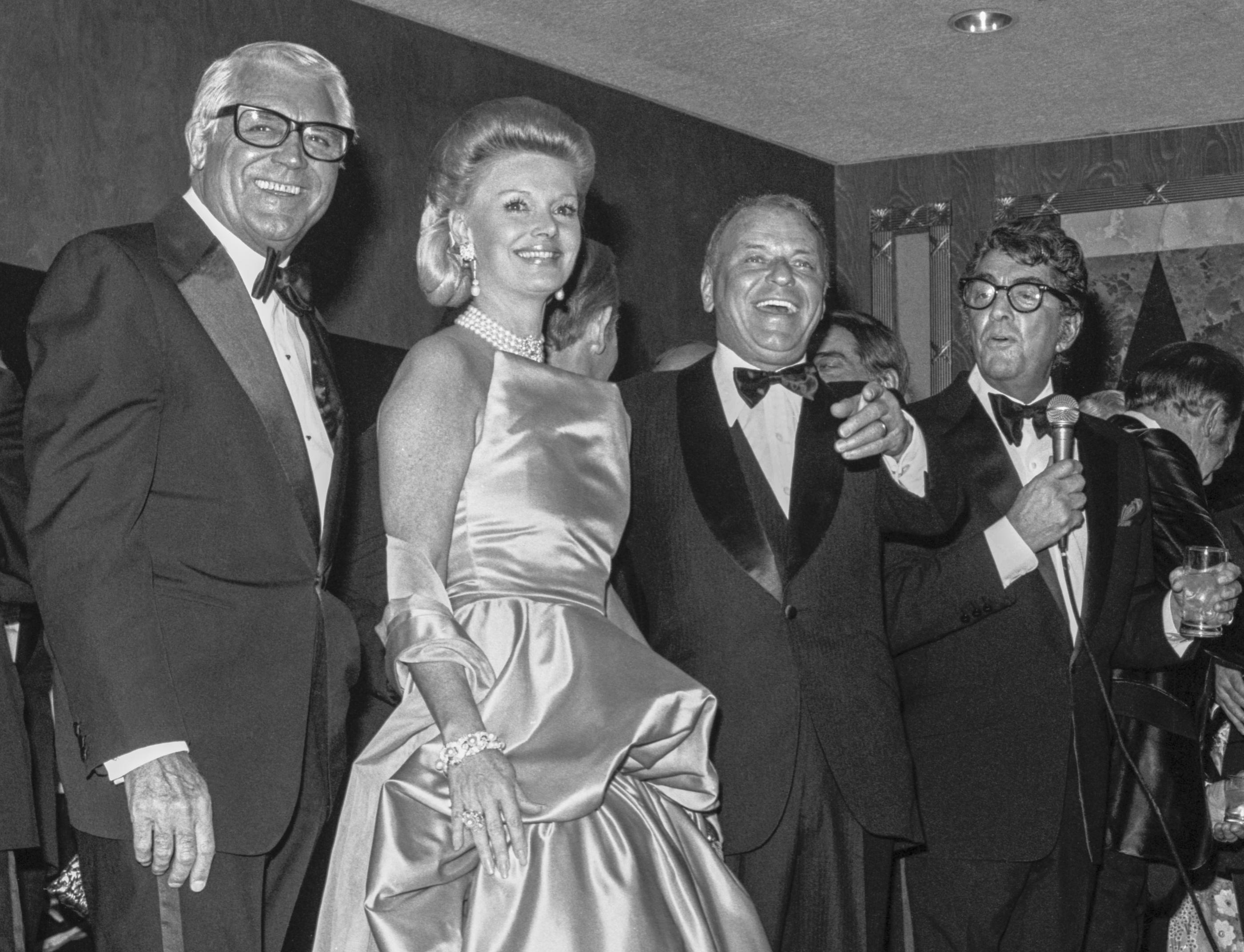 Actor Cary Grant, from left, Barbara Sinatra, Frank Sinatra and Dean Martin pose during Frank Sinatra's 40th Anniversary party at the Paramount Theater at Caesars Palace in Las Vegas on December 12, 1979. CREDIT: Cliff Stanley-Gary Angel/Las Vegas News Bureau