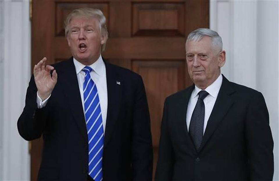 Defense Secretary James Mattis suggested its time to end the war in Afghanistan after 40 years of conflict and other nations need to step forward to urge the peace process. Mattis pictured here in 2016 with then President-elect Trump, resides in Richland, Washington and graduated from Central Washington University in Ellensburg. (Carolyn Kaster AP)