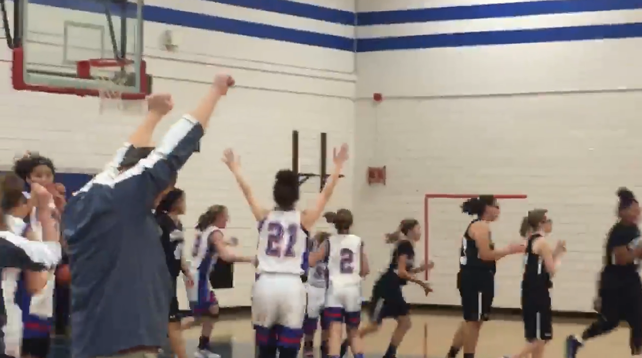 "Worthingway Middle School student-athlete Ellie Savage-Trout beat the buzzer in her game against the Norton Wolves. It was her first basket against ""her typical peers,"" according to her mom. (Credit: Zena Trout)"
