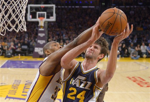 Utah Jazz center Jeff Withey, right, shoots as Los Angeles Lakers forward Metta World Peace defends during the first half of an NBA basketball game, Sunday, Jan. 10, 2016, in Los Angeles. (AP Photo/Mark J. Terrill)