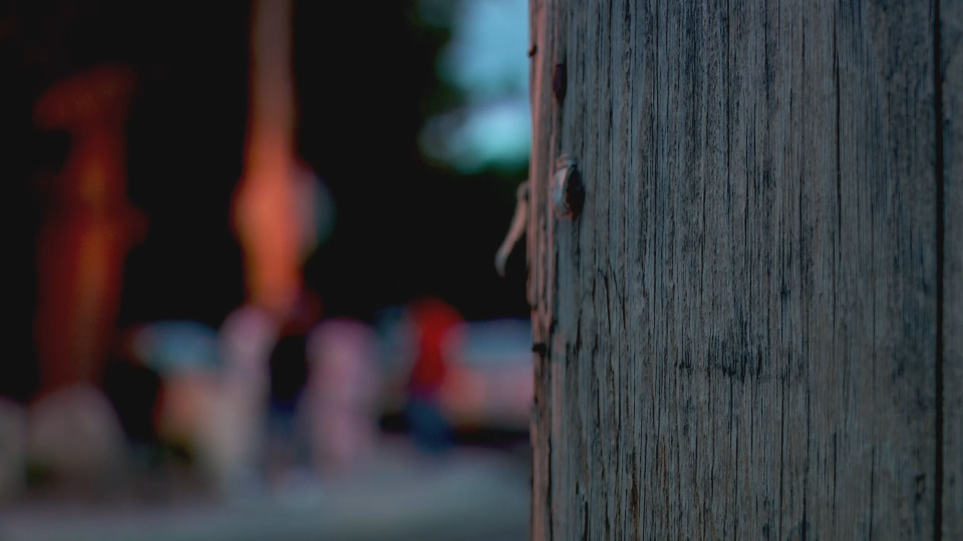 Bystanders gather outside crime scene tape near the spot where 17-year-old Edwin Reyes was killed in West Valley City on June 28, 2020. (Photo: KUTV)<p></p>
