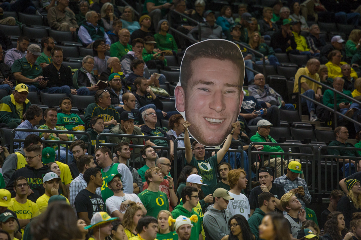 Duck fans hold up a massive fathead depicting Oregon guard Charlie Noebel's (#10) face. After trailing for most of the game, the Oregon Ducks defeated the Boise State Broncos 68-63. Photo by Dillon Vibes