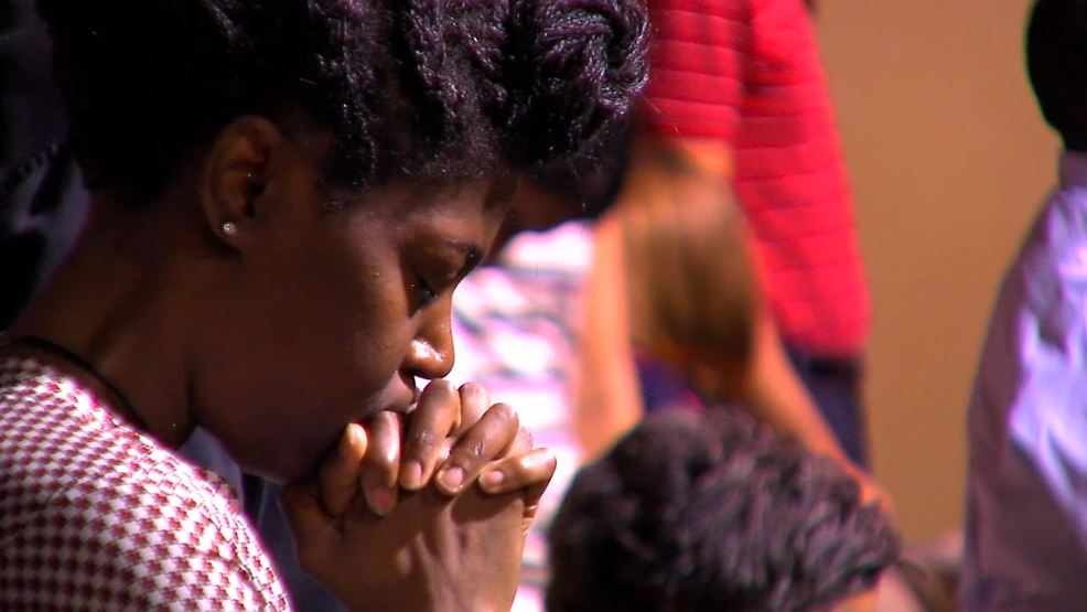 Community opts for prayer to ease the pain of Crutcher killing