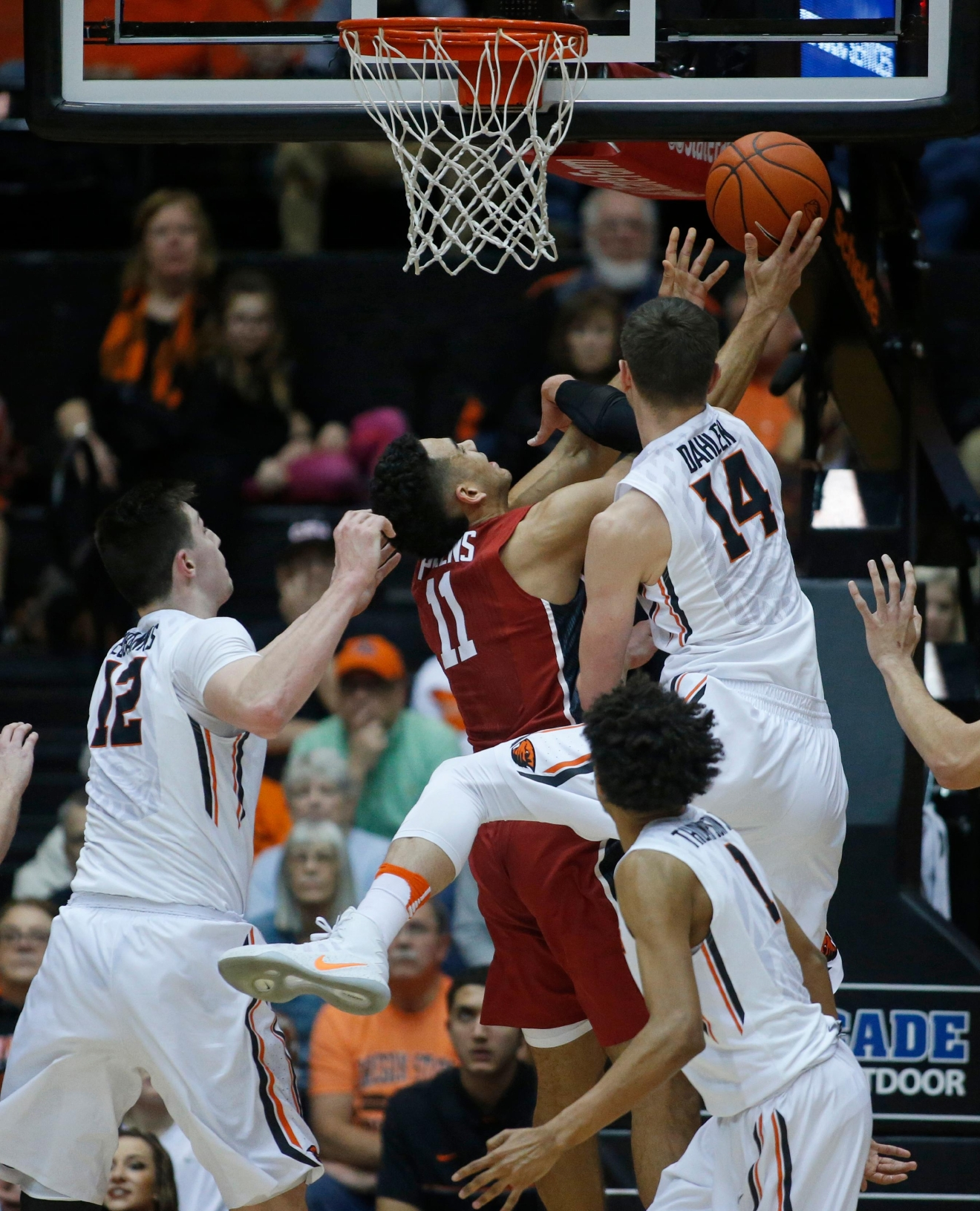 Stanford's Dorian Pickens (11) is fouled by Oregon State's Matt Dahlen (14) during the first half of an NCAA college basketball game in Corvallis, Ore., Thursday, Jan. 19, 2017. (AP Photo/Timothy J. Gonzalez)