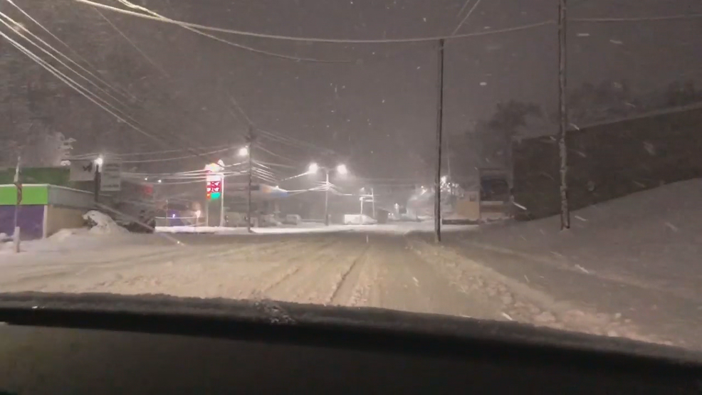Buncombe County snow continues to fall, thousands without power