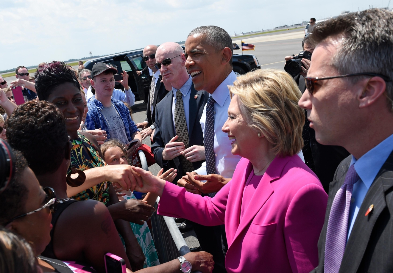 President Barack Obama and Democratic presidential candidate Hillary Clinton greet people on the tarmac after arriving at North Carolina Air National Guard Base in Charlotte, N.C., Tuesday, July 5, 2016. Obama is spending the afternoon campaigning for Clinton. (AP Photo/Susan Walsh)