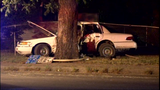 Suspected drunk driver wraps car around tree; 2 injured