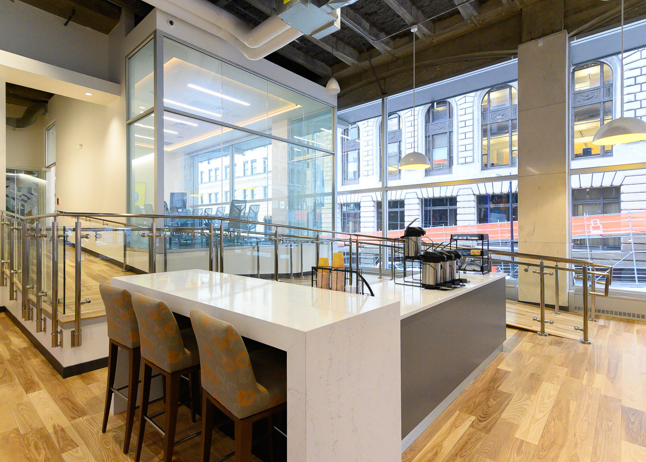 A high-top bar area sits adjacent to the coffee bar. A handicap-accessible ramp snakes around it to allow wheelchair users access to the two conference rooms in the back of the space. / Image: Phil Armstrong, Cincinnati Refined // Published: 2.25.20
