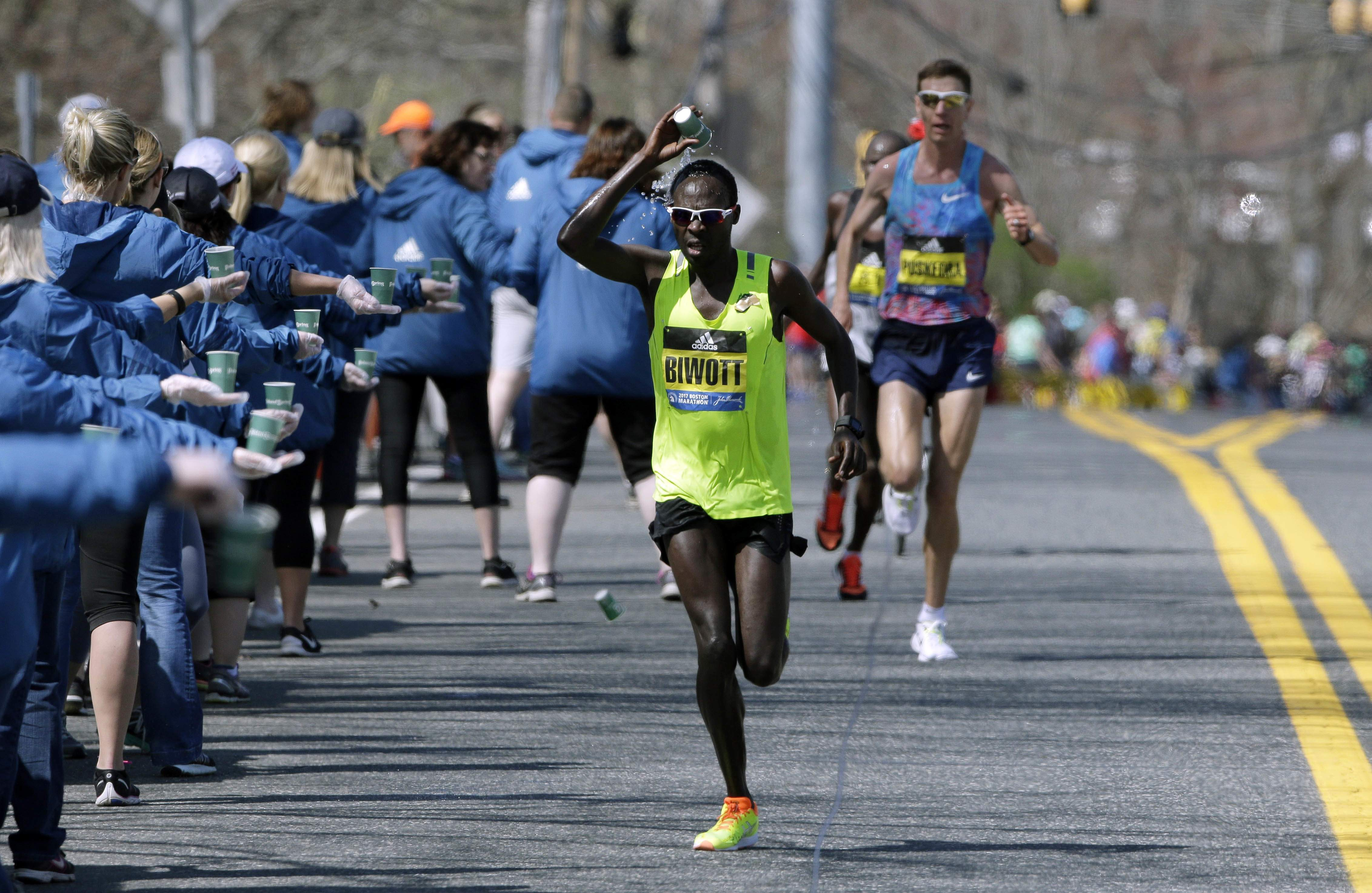 Shadrack Biwott, of the United States, douses himself while running along the course of the 121st Boston Marathon on Monday, April 17, 2017, in Natick, Mass. THE ASSOCIATED PRESS