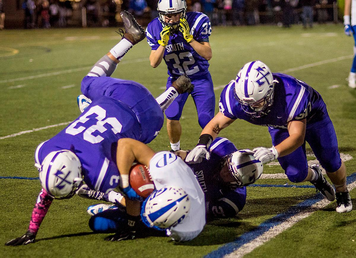 Grants Pass Cavemen Tyler Rund (#11) attempts to keep control of the ball. Grants Pass Cavemen defeated South Eugene Axemen 13-6 on Friday night at South Eugene. Photo by Rhianna Gelhart, Oregon News Lab