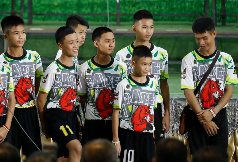 Members of the rescued soccer team attend a press conference discussing their experience being trapped in the cave in Chiang Rai, northern Thailand, Wednesday, July 18, 2018. The 12 boys and their soccer coach rescued after being trapped in a flooded cave in northern Thailand are recovering well and are eager to eat their favorite comfort foods after their expected to go home soon. (AP Photo/Vincent Thian)