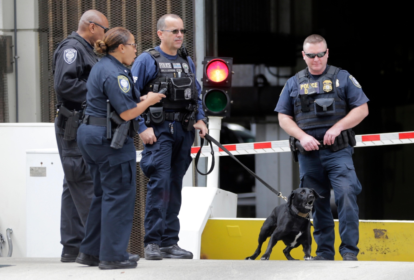 Police stand outside of Federal Court where Esteban Santiago is attending a hearing after being charged with committing violence against people at an international airport resulting in death and two firearms offenses, Monday, Jan. 9, 2017, in Fort Lauderdale, Fla. This follows the shooting at Fort Lauderdale-Hollywood International Airport Friday. (AP Photo/Lynne Sladky)