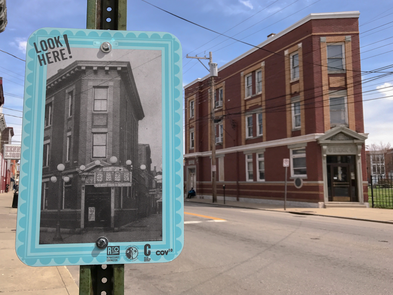 At its northern border, Look Here! Covington brilliantly highlights what an old building on Pike Street used to look like in years past.  / Image: Phil Armstrong, Cincinnati Refined // Published: 5.7.17
