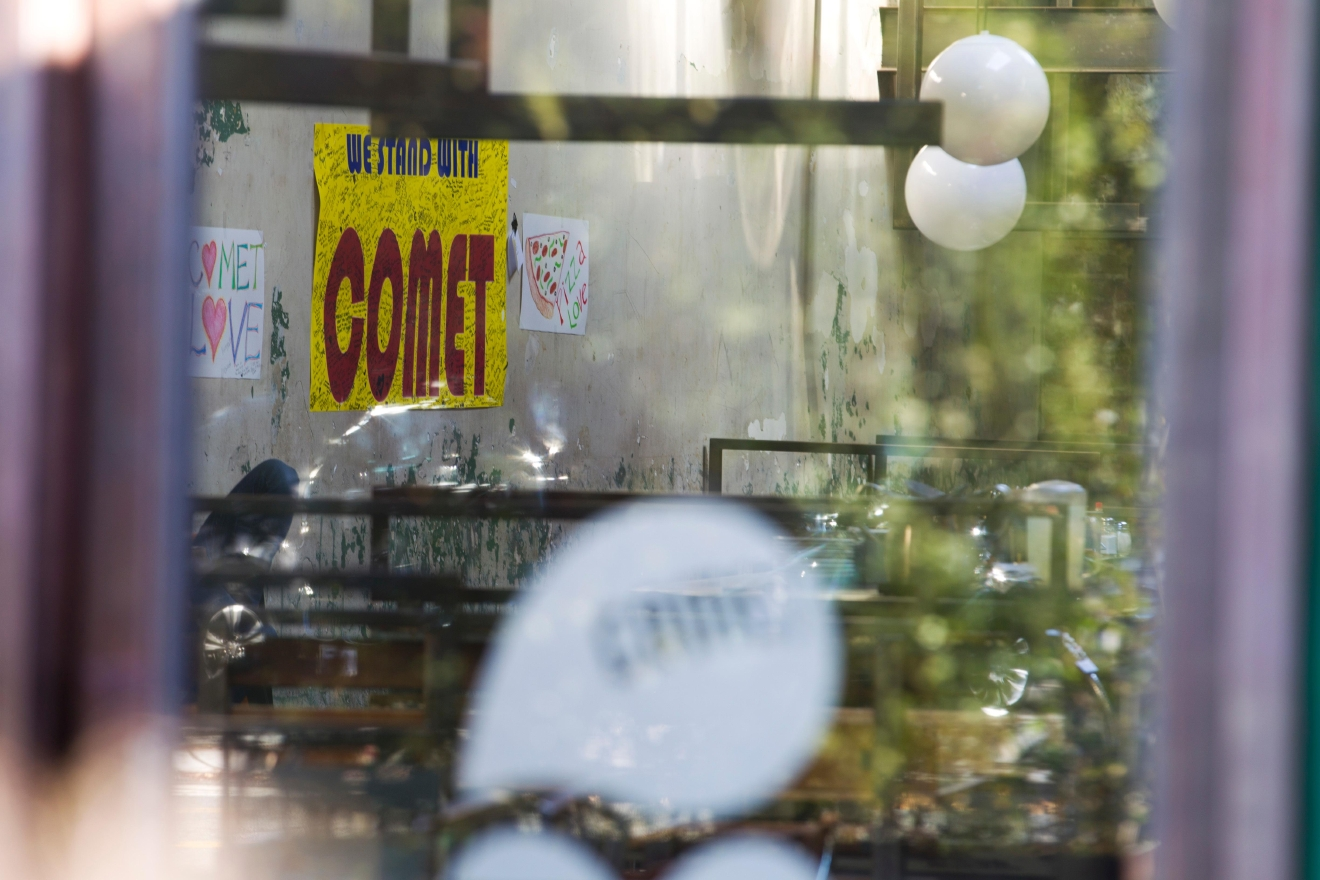 The front door of Comet Ping Pong pizza shop, in Washington, Monday, Dec. 5, 2016. ( AP Photo/Jose Luis Magana)