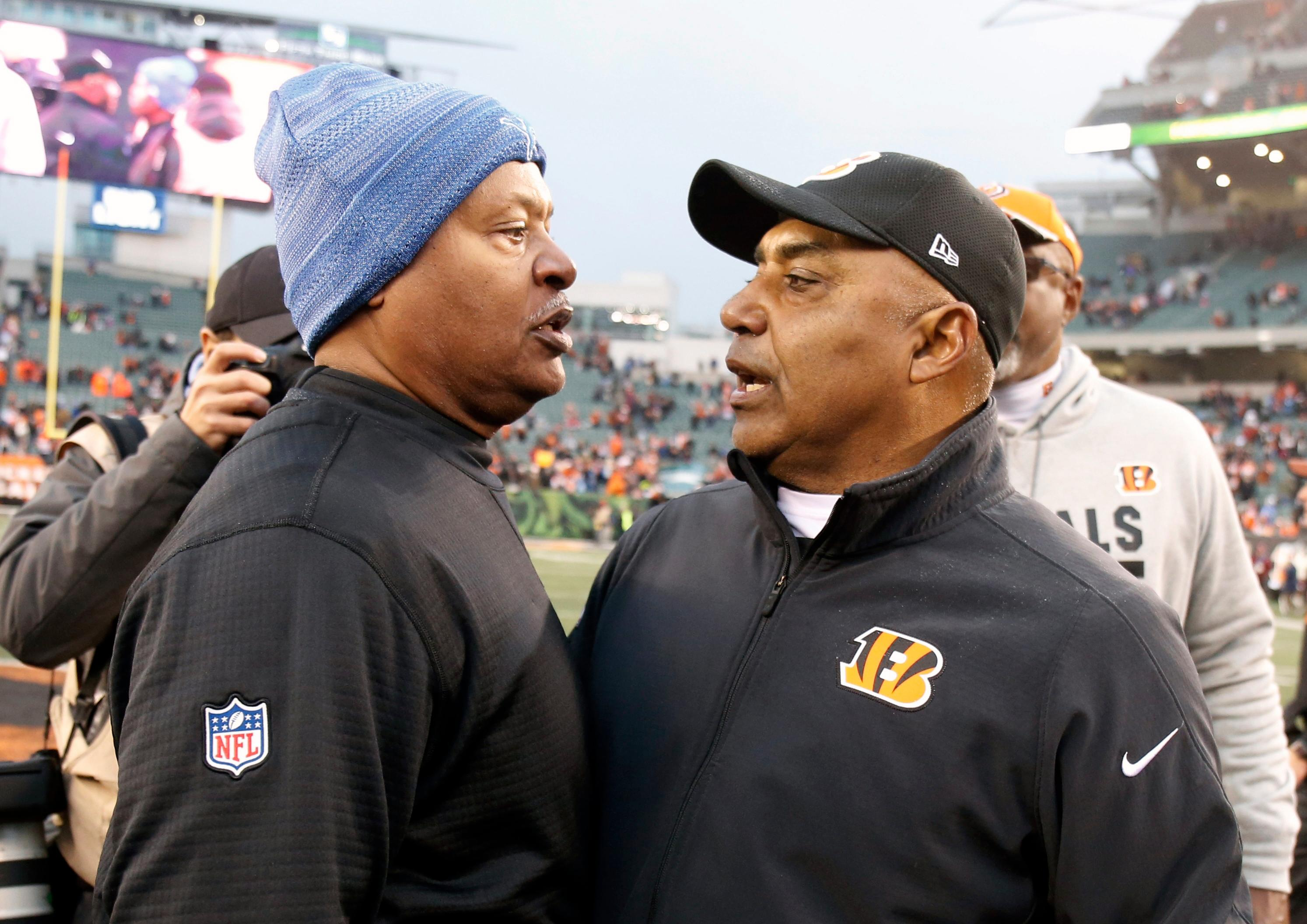 Detroit Lions head coach Jim Caldwell, left, meets with Cincinnati Bengals head coach Marvin Lewis after their NFL football game, Sunday, Dec. 24, 2017, in Cincinnati. (AP Photo/Gary Landers)