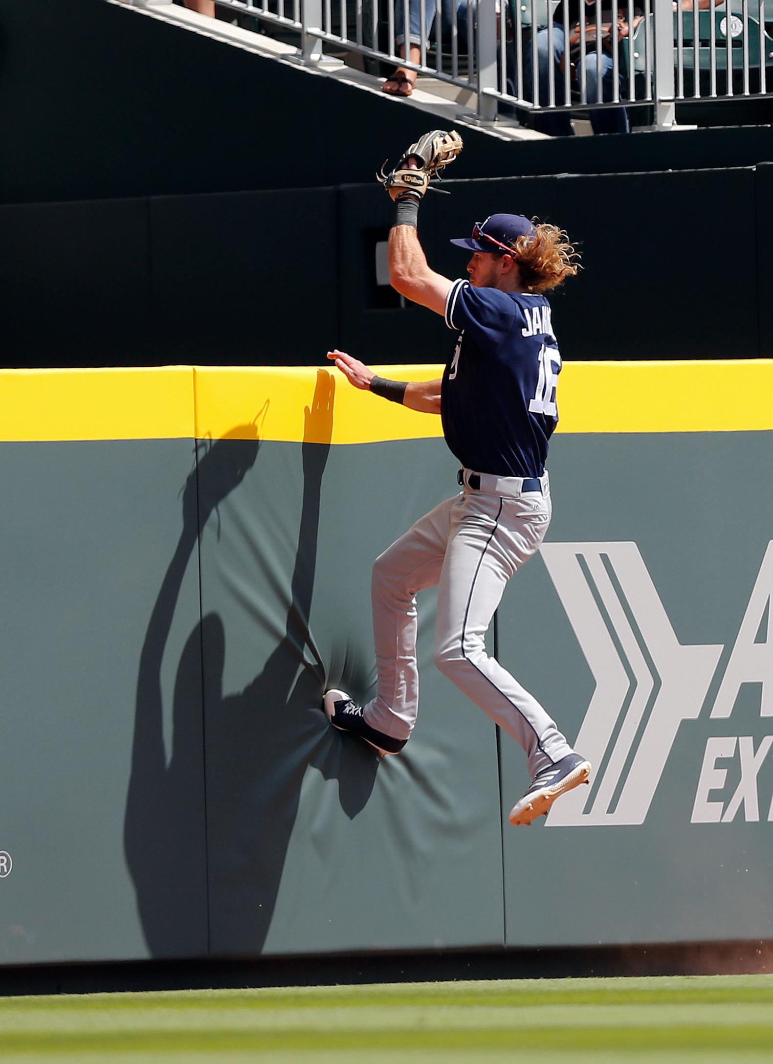 San Diego Padres center fielder Travis Jankowski (16) catches a flyball from Atlanta Braves' Jace Peterson in the seventh inning of a baseball game, Sunday, April 16, 2017, in Atlanta. Atlanta won 9-2. (AP Photo/John Bazemore)