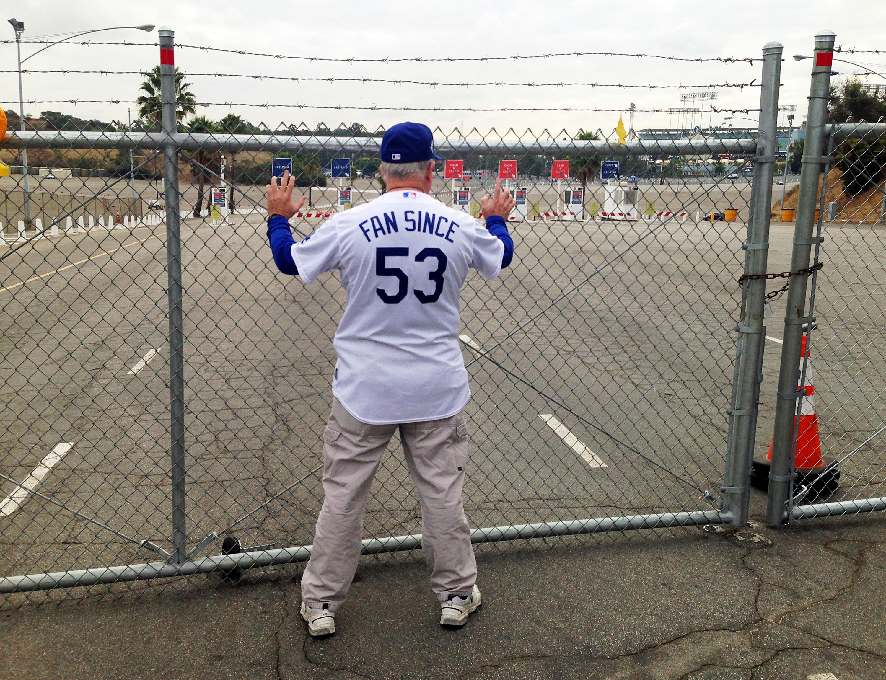 "Ron Cervenka stands in front of an entrance gate to Dodger Stadium some eight hours before game time, waiting to be the first person inside for World Series Game 7 between the Dodgers and the Houston Astros Wednesday, Nov. 1, 2017. ""I knew this team was special, even in spring training,"" said the retired police detective, who saw his first World Series game in 1963, watching as Dodgers Hall of Fame pitcher Don Drysdale shut out the Yankees 1-0 on a three-hitter. His jersey refers to his birth year, 1953. (AP Photo/John Rogers)"