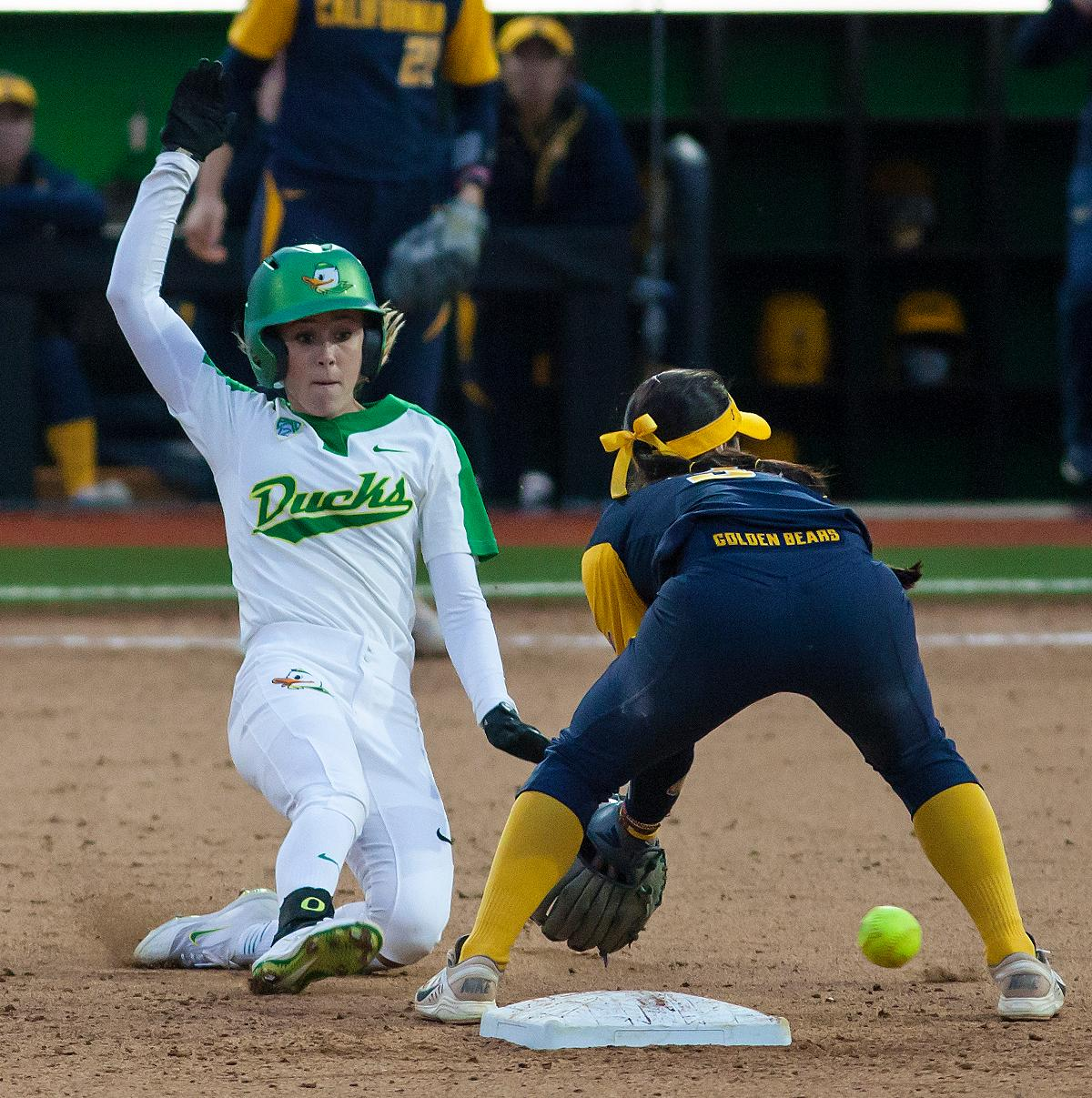 Oregon infielder Alexis Mack (#10) slides into second base as California infielder Kylie Reed (#3) reaches to pickup the ball. California infielder Bradie Fillmore (#4) catches the ball before tagging out Oregon utility player Lauren Lindvall (#8). In the first of a three game series the Oregon Ducks defeated the California Golden Bears five to one. Photo by Ben Lonergan, Oregon News Lab