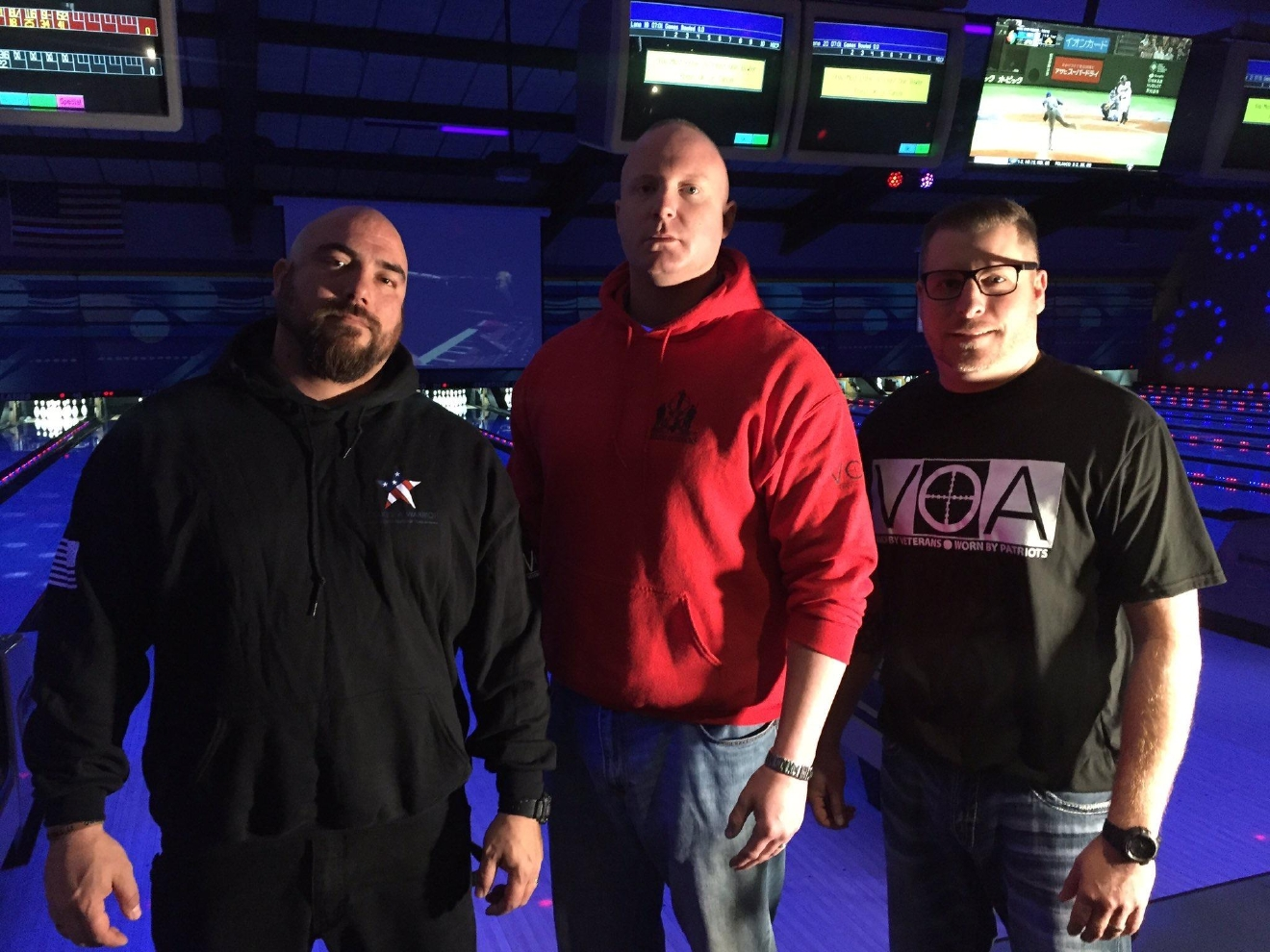 Veterans Zak Jaime (left), Ryan Hageness, and Brent Mason (right) help organize Warrior Bowl Competition at Stardust Lanes in Saginaw Township.