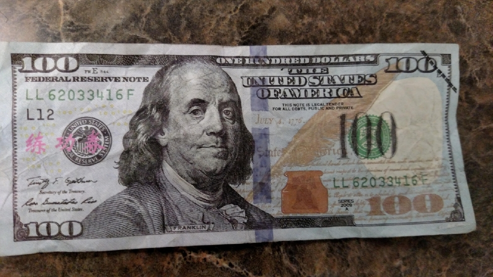 how to tell a counterfeit 50 dollar bill