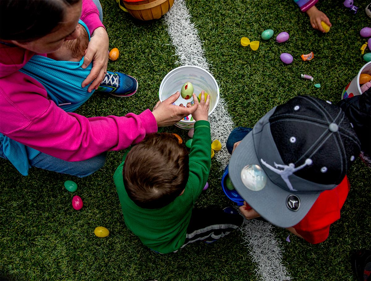 Hundreds of kids from young babies to school age converged on Marist High School on Saturday for a helicopter Easter egg drop. The event, put on by Joy Church, loaded up a large bucket with eggs then dropped it across the Marist football field by helicopter. Photo by August Frank, Oregon News Lab