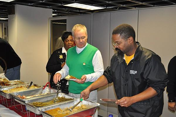 Mike Murphy and Chris Oliver serving lunch