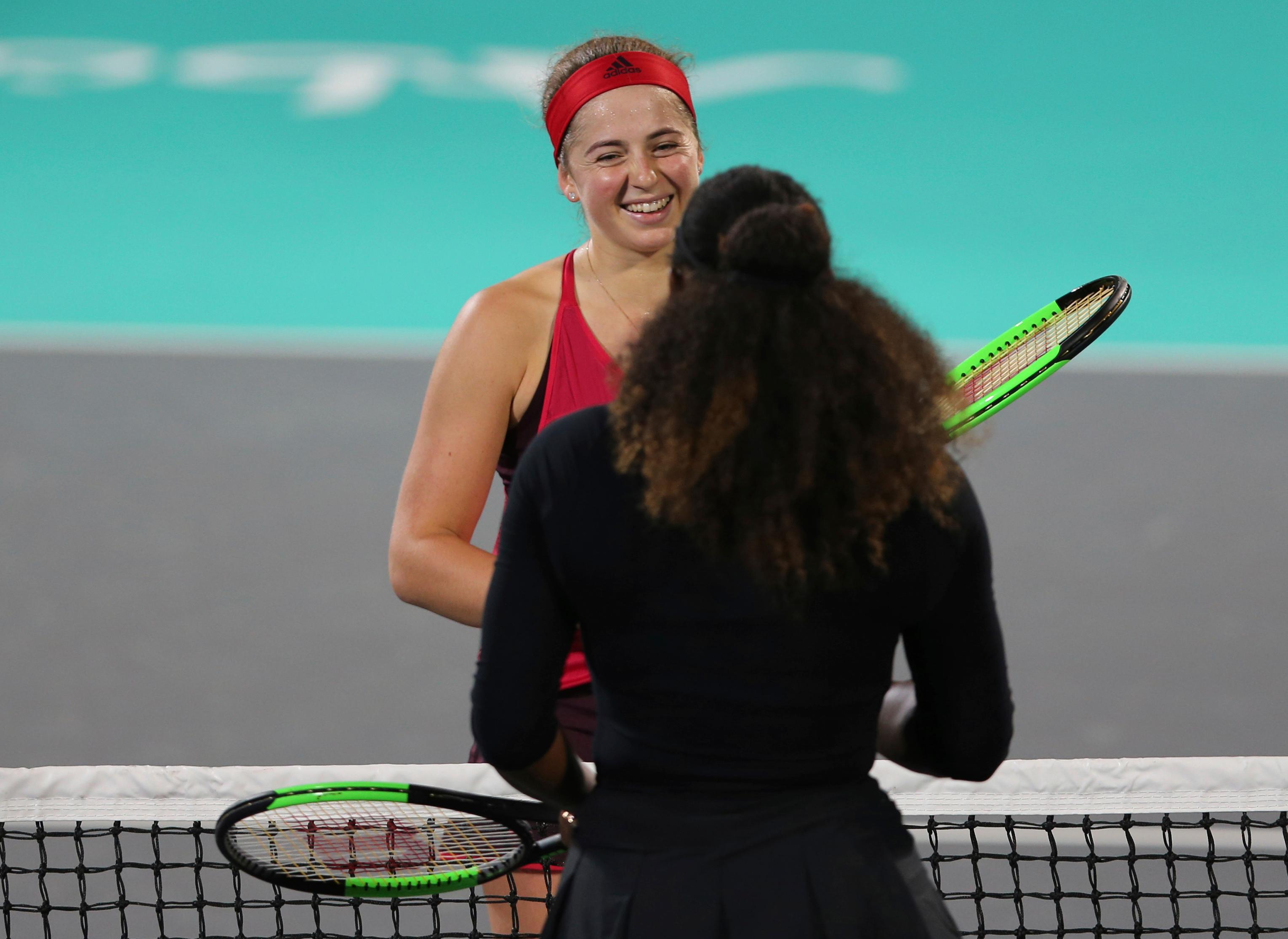Jelena Ostapenko, of Latvia, celebrates after beating Serena Williams, foreground, of the U.S., in an exhibition match during the final day of the Mubadala World Tennis Championship in Abu Dhabi, United Arab Emirates, Saturday, Dec. 30, 2017. (AP Photo/Kamran Jebreili)
