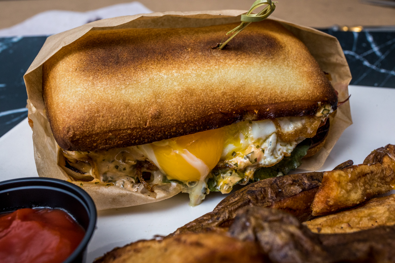 "<p>PLACE: Butcher and Barrel / ADDRESS: 700 Race Street (Downtown) /{&nbsp;}The Lomito: sous vide short rib, fried pork loin, romaine, confit tomatoes, caramelized onions, mozzarella cheese, ciabatta bread, chimi mayo, and sunny side up egg /{&nbsp;}<a  href=""https://sinclairstoryline.com/thebutcherbarrel.com/online-ordering/"" target=""_blank"" title=""thebutcherbarrel.com/online-ordering/"">Order online{&nbsp;}</a>or with{&nbsp;}<a  href=""https://www.ubereats.com/cincinnati/food-delivery/butcher-and-barrel-700-race-st/WD2Uxn6cSiSnXz7BuBb-AA"" target=""_blank"" title=""https://www.ubereats.com/cincinnati/food-delivery/butcher-and-barrel-700-race-st/WD2Uxn6cSiSnXz7BuBb-AA"">Uber Eats</a>{&nbsp;}/ Image: Catherine Viox // Published: 1.10.21</p>"