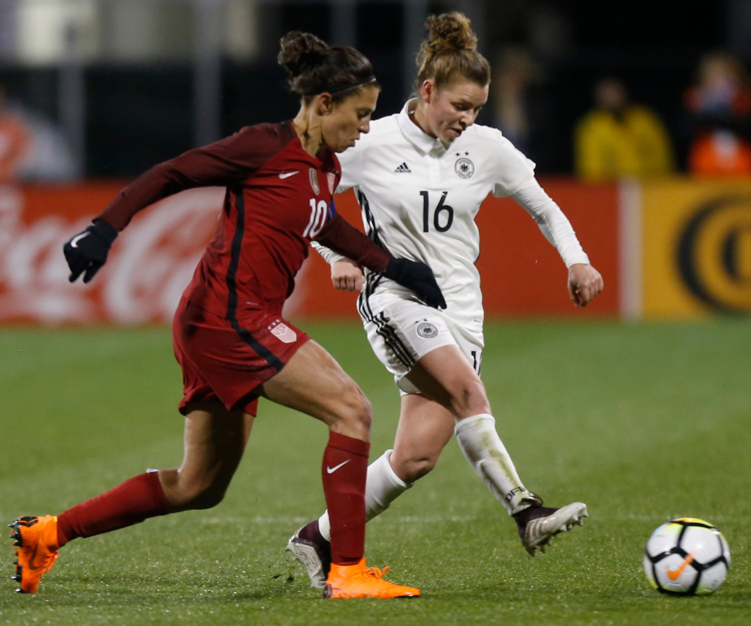 United States' Carli Lloyd, left, and Germany's Linda Dallmann chase the ball during the first half of a SheBelieves Cup women's soccer match Thursday, March 1, 2018, in Columbus, Ohio. (AP Photo/Jay LaPrete)