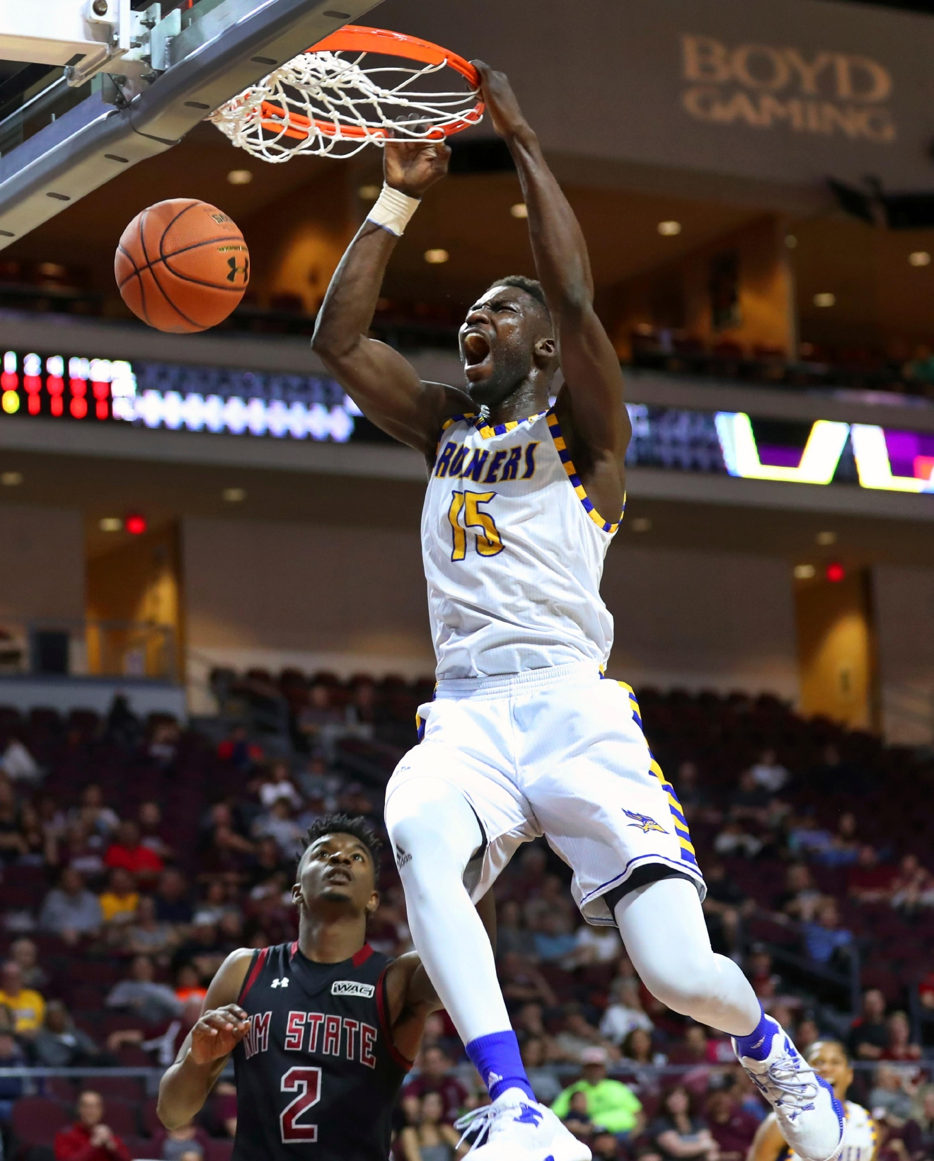 Cal State Bakersfield center Fallou Ndoye dunks over New Mexico State guard Braxton Huggins during the first half of an NCAA college basketball game in the final of the Western Athletic Conference tournament on Saturday, March 11, 2017, in Las Vegas. (AP Photo/L.E. Baskow)
