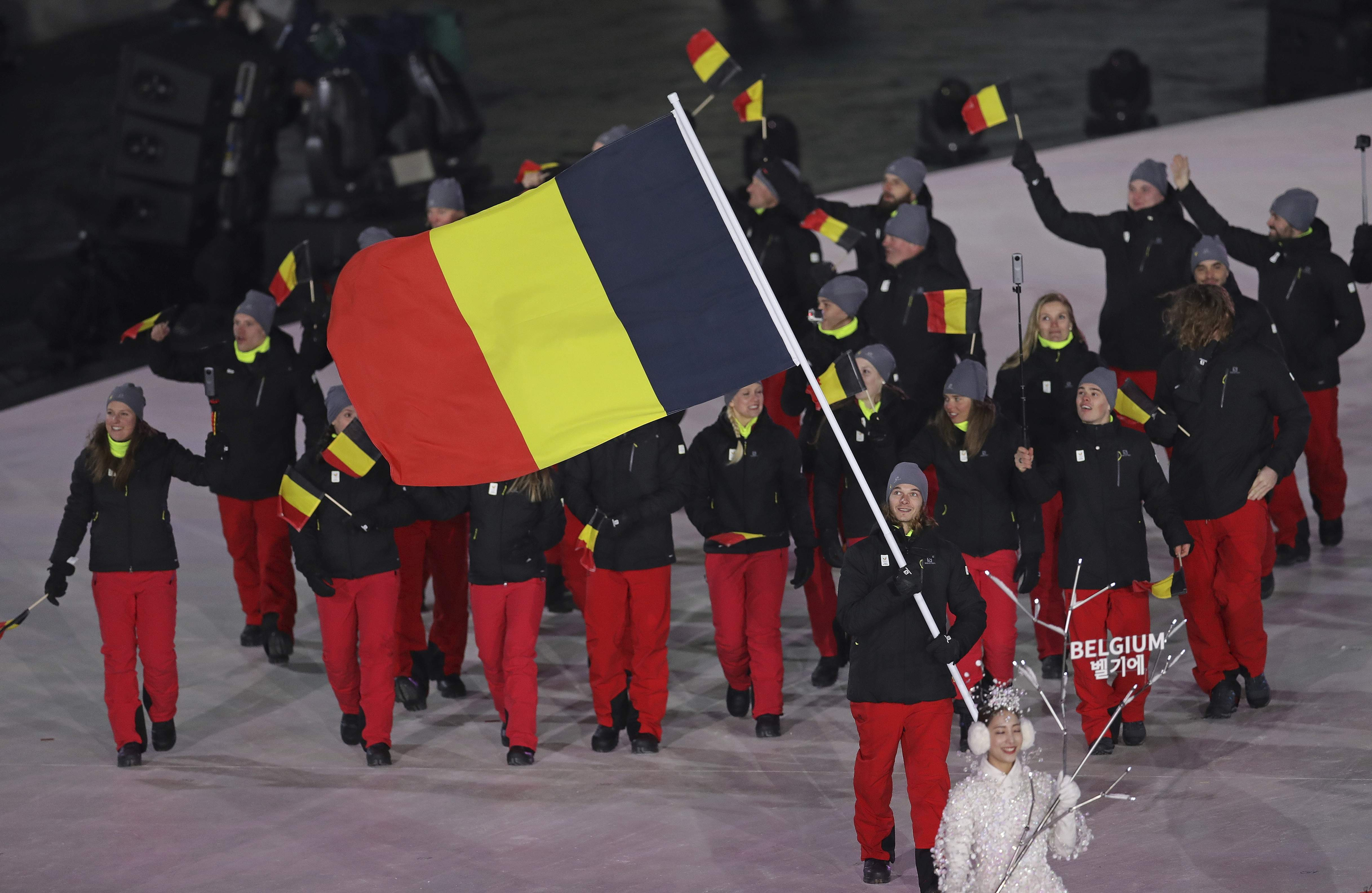 Seppe Smits carries the flag of Belgium during the opening ceremony of the 2018 Winter Olympics in Pyeongchang, South Korea, Friday, Feb. 9, 2018. (AP Photo/Michael Sohn)