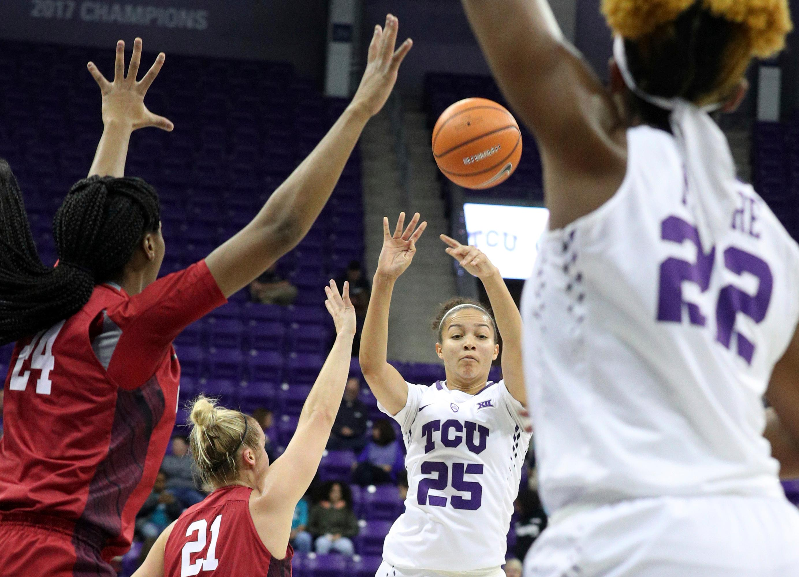 TCU guard Kianna Ray (25) passes the ball to TCU center Jordan Moore (22) during an NCAA college basketball game in Fort Worth, Texas, Saturday, Jan. 27, 2018. (Richard W. Rodriguez/Star-Telegram via AP)