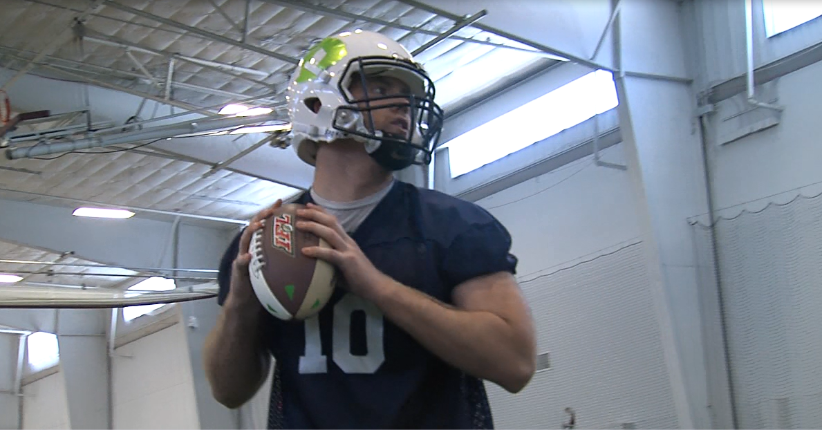Patrick McCain, a quarterback for the Nebraska Danger, drops back to pass on May 16, 2017, during practice at the Community Fieldhouse (NTV news)