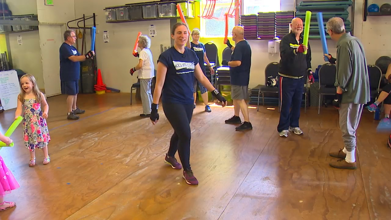 Fourteen people travel to Snohomish Fitness twice a week to box and to battle their Parkinson's disease. (Photo: KOMO News).