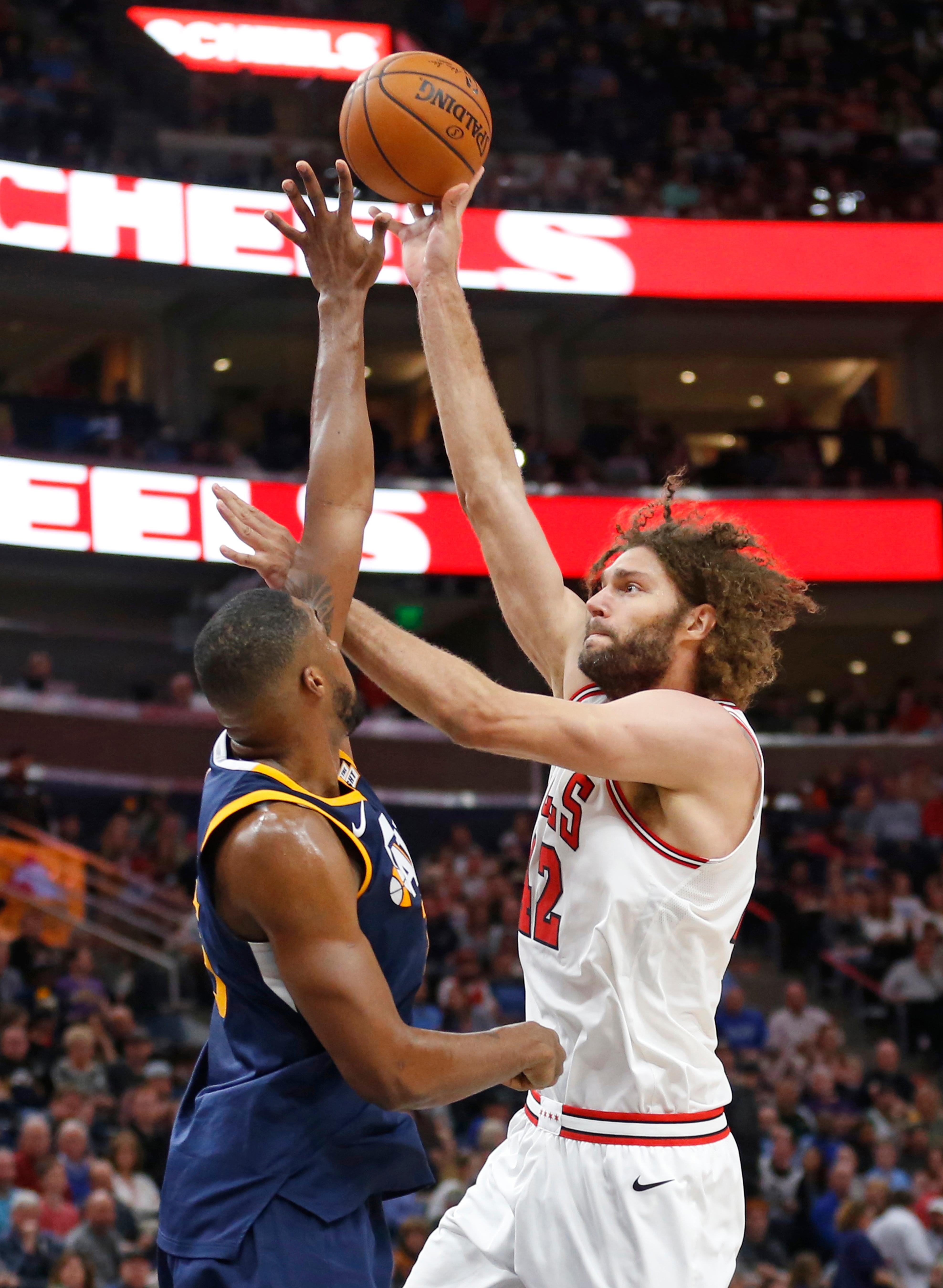 Chicago Bulls center Robin Lopez, right, shoots as Utah Jazz forward Derrick Favors defends during the first half of an NBA basketball game Wednesday, Nov. 22, 2017, in Salt Lake City. (AP Photo/Rick Bowmer)