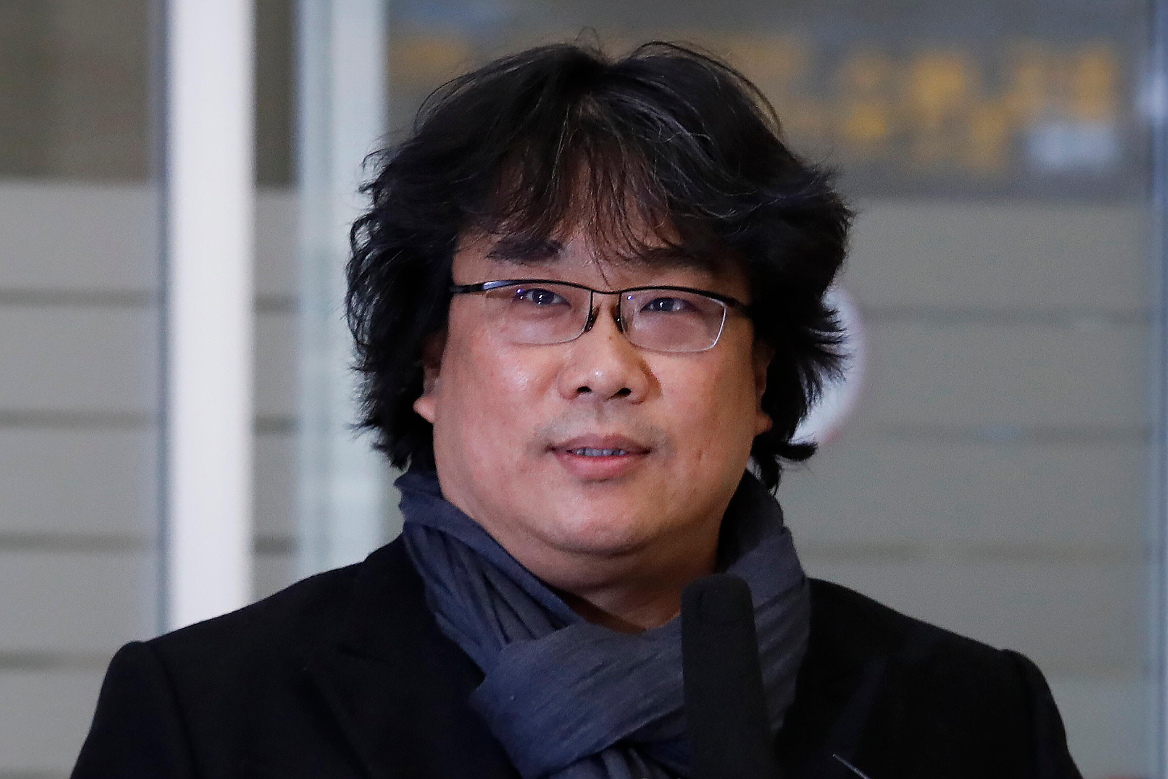 "South Korean director Bong Joon-ho speaks upon his arrival at the Incheon International Airport in Incheon, South Korea, Sunday, Feb. 16, 2020. South Koreans are reveling in writer-director Bong's dark comic thriller, ""Parasite,"" which won this year's Academy Awards for best film and best international feature. The movie itself, however, doesn't put the country in a particularly positive light. (AP Photo/Ahn Young-joon)"