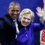 Obama, Clinton embrace on stage at convention