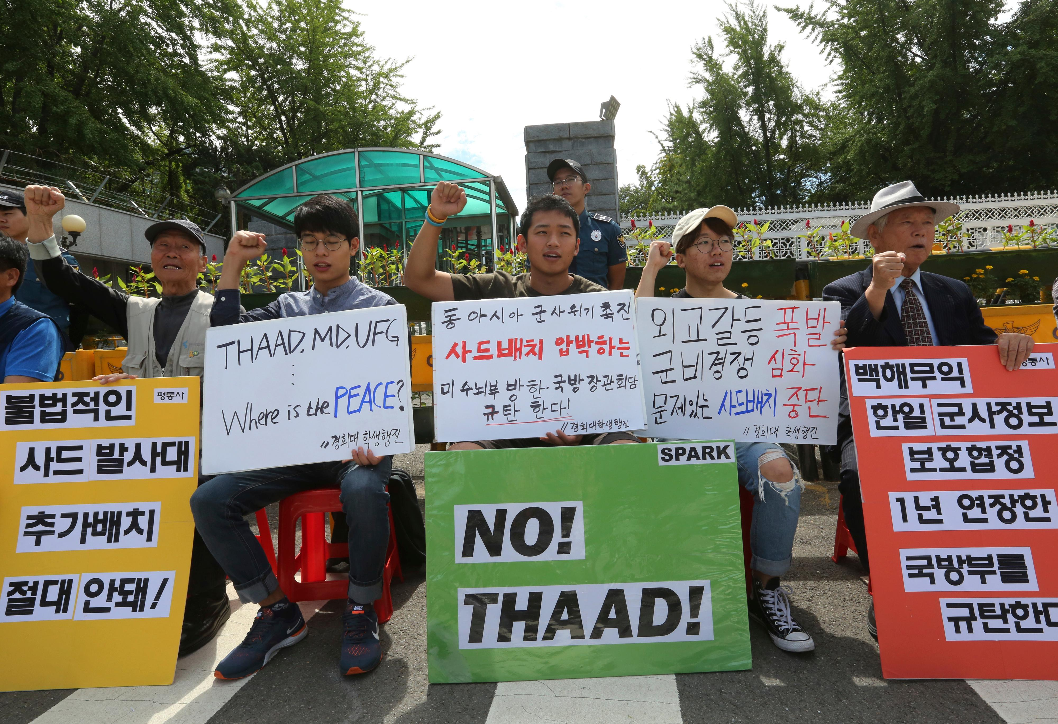"South Korean protesters stage a rally against the deployment of an advanced U.S. missile defense system called Terminal High-Altitude Area Defense, or THAAD, near the Defense Ministry in Seoul, South Korea. The signs read "" Opposed the deployment of the THAAD"". (AP Photo/Ahn Young-joon)"