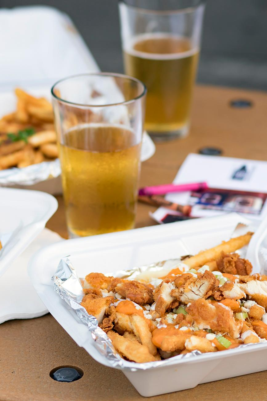 Buffalo chicken poutine: french fries, cheese curds, buffalo gravy, fried chicken, diced celery, bleu cheese crumbles, and topped with ranch dressing / Image: Allison McAdams // Published:{ }5.11.19