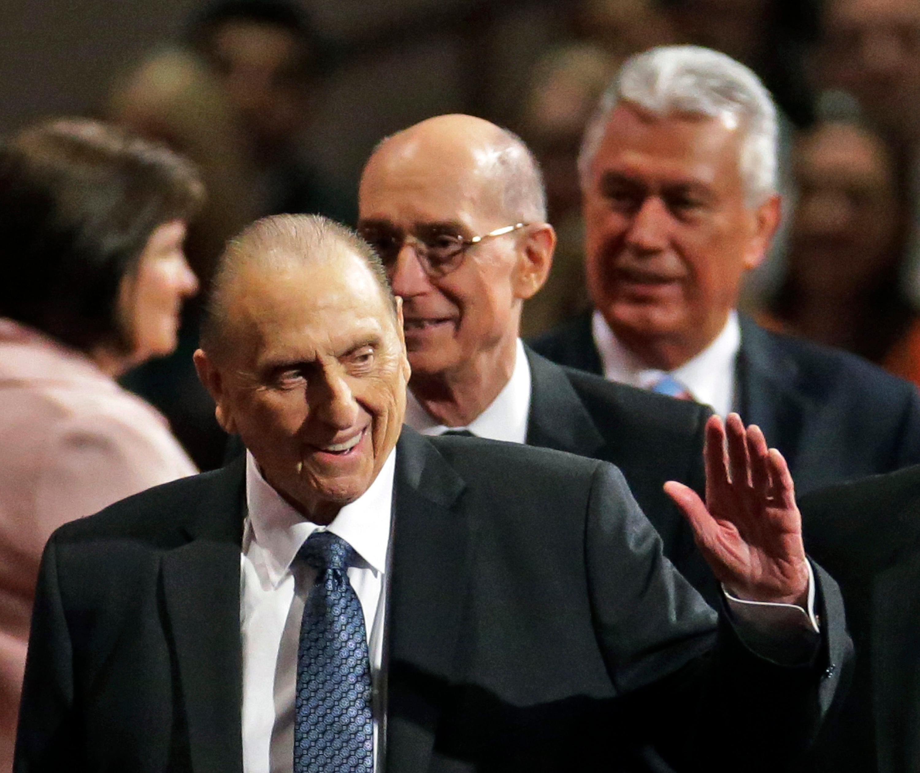 FILE - In this April 4, 2015, file photo, President Thomas S. Monson, of The Church of Jesus Christ of Latter-day Saints, waves to the audience during the opening session of the Mormon church conference in Salt Lake City. Monson, the 16th president of the Mormon church, died after nine years in office. He was 90. (AP Photo/Rick Bowmer, File)