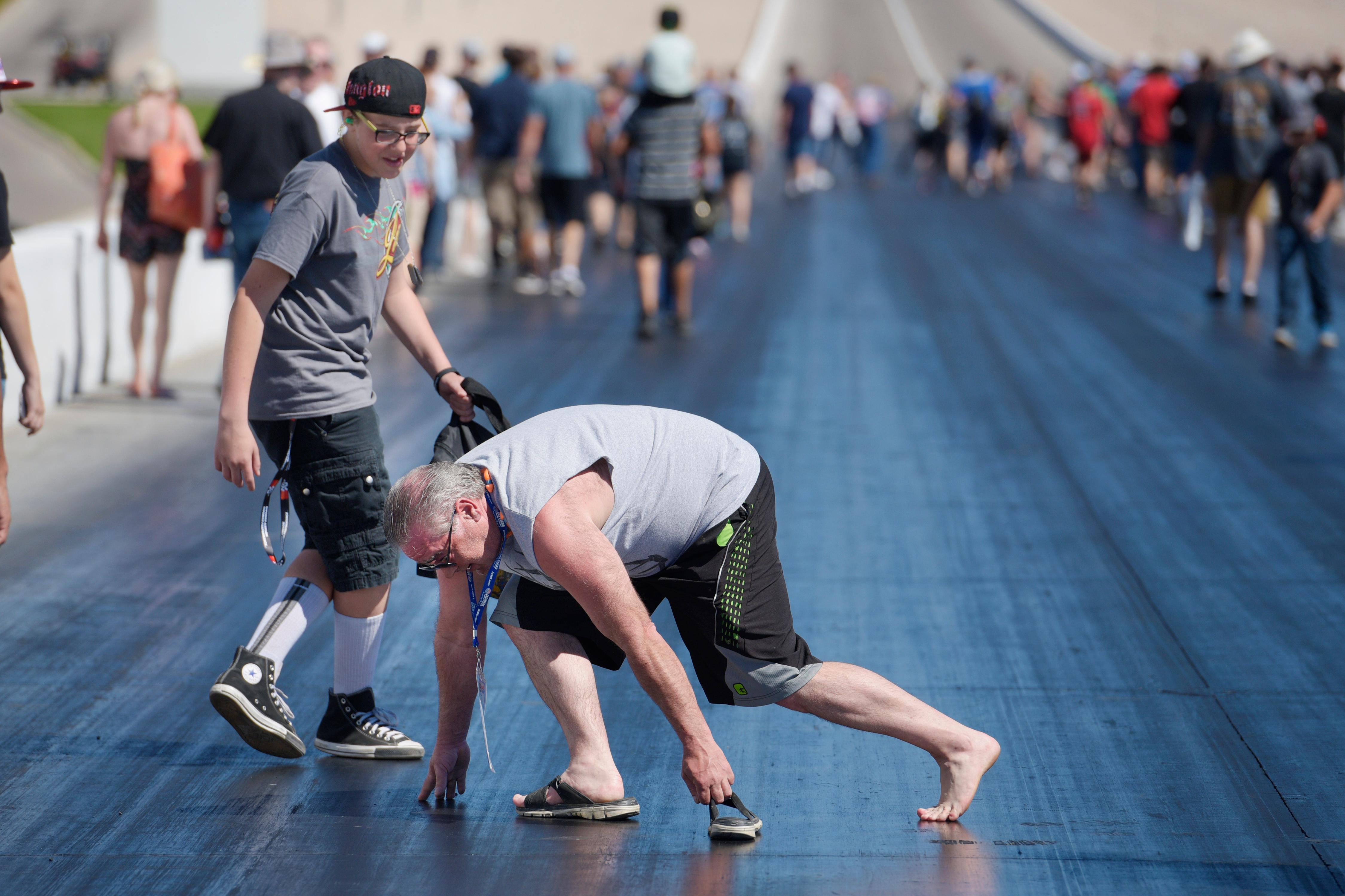 A fan loses his sandal during the track walk before the NHRA DENSO Spark Plug Nationals at The Strip at the Las Vegas Motor Speedway Sunday, April 2, 2017. (Sam Morris/Las Vegas News Bureau)