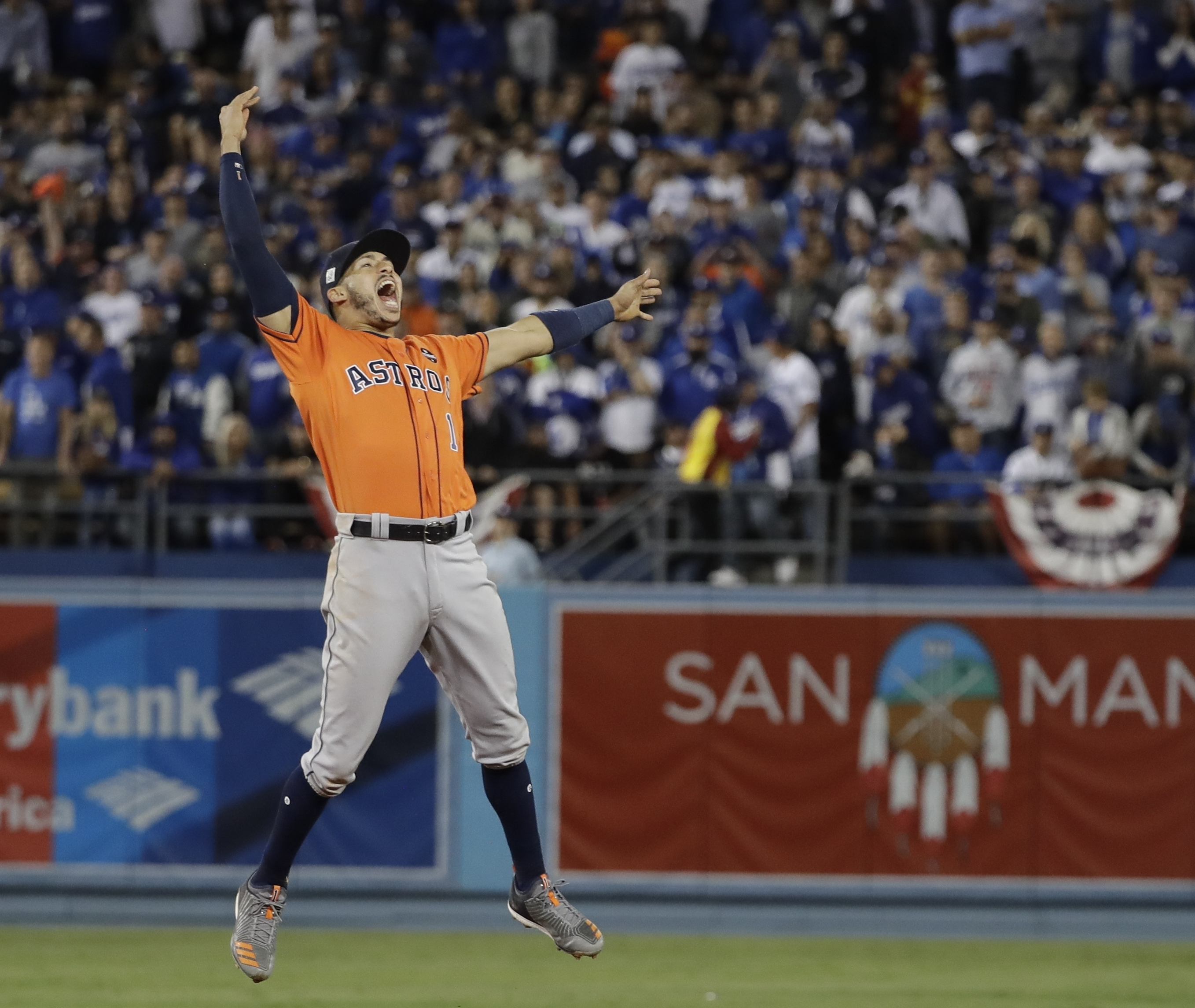 Houston Astros' Carlos Correa celebrates after Game 7 of the World Series against the Los Angeles Dodgers Wednesday, Nov. 1, 2017, in Los Angeles. (AP Photo/David J. Phillip)