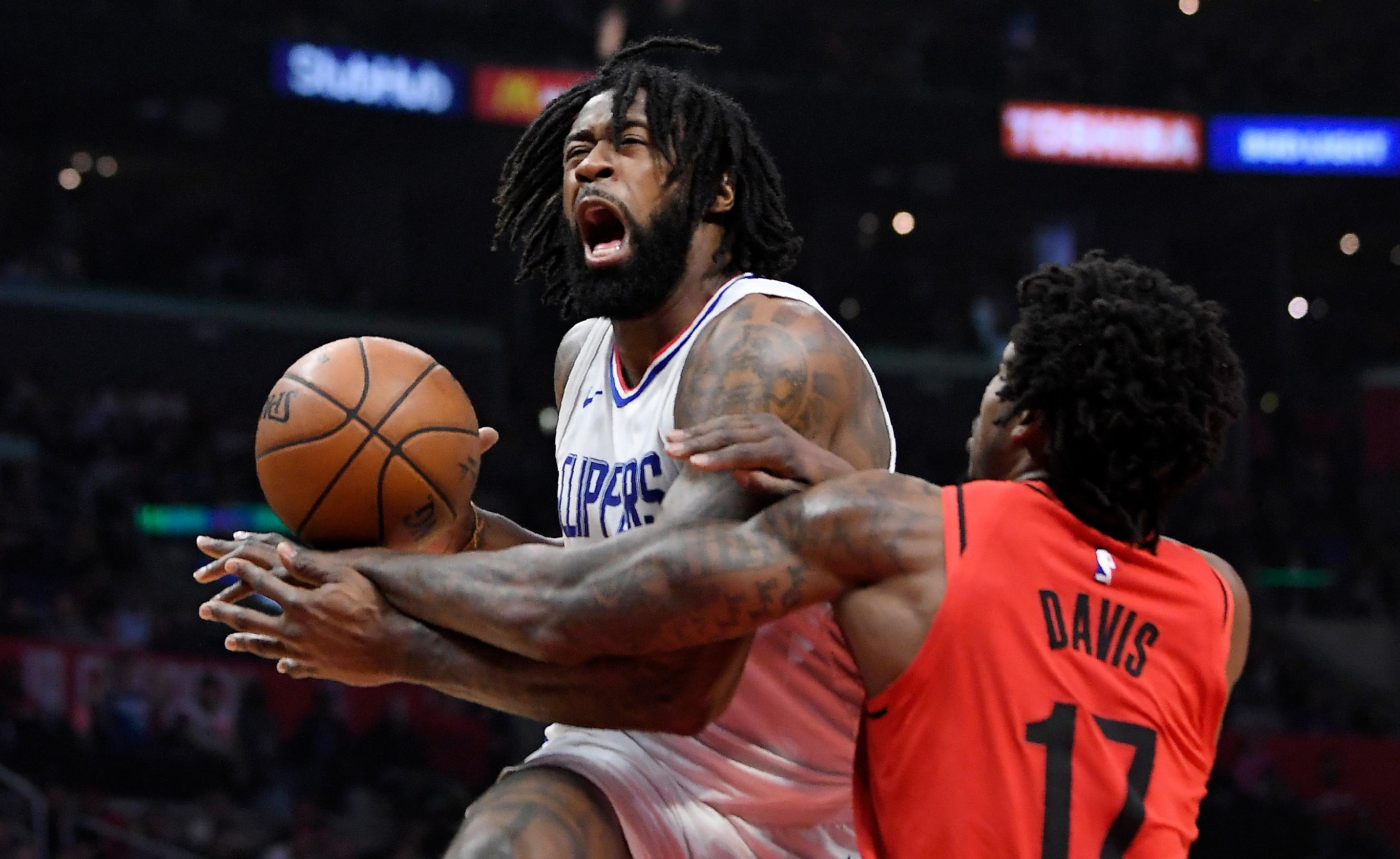 Portland Trail Blazers forward Ed Davis, right, reaches in on Los Angeles Clippers center DeAndre Jordan during the first half of an NBA basketball game, Tuesday, Jan. 30, 2018, in Los Angeles. (AP Photo/Mark J. Terrill)