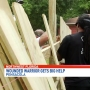 Strangers build fence at wounded warrior's Pensacola home