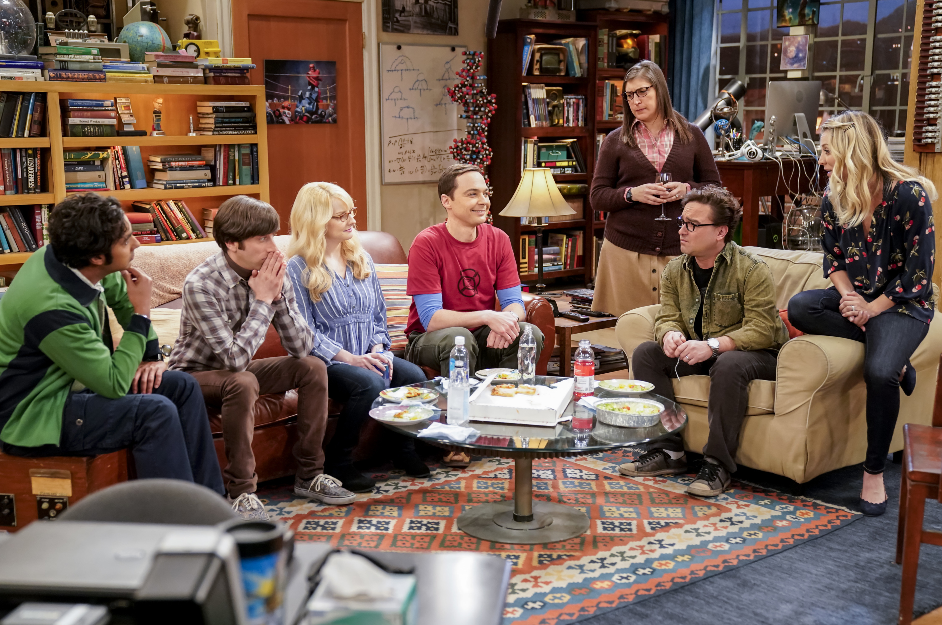 "This image released by CBS shows Kunal Nayyar,  from left, Simon Helberg, Melissa Rauch, Jim Parsons, Mayim Bialik, Johnny Galecki and Kaley Cuoco appear in a scene from the long-running comedy series ""The Big Bang Theory."" The popular series will end in 2019. (Erik Voake/CBS via AP)"