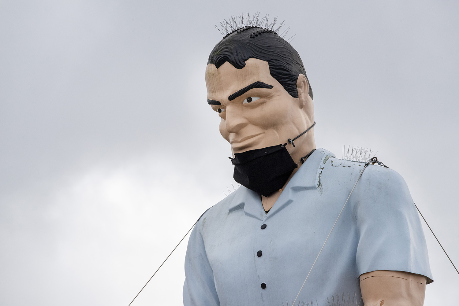 According to Herald Net, the Muffler Man's 18-foot face mask was created by Everett Tent & Awning and made of outdoor fabric and rubber bungee cords. Recent strong winds have caused the mask to slip down a bit. (Rachael Jones / Seattle Refined)