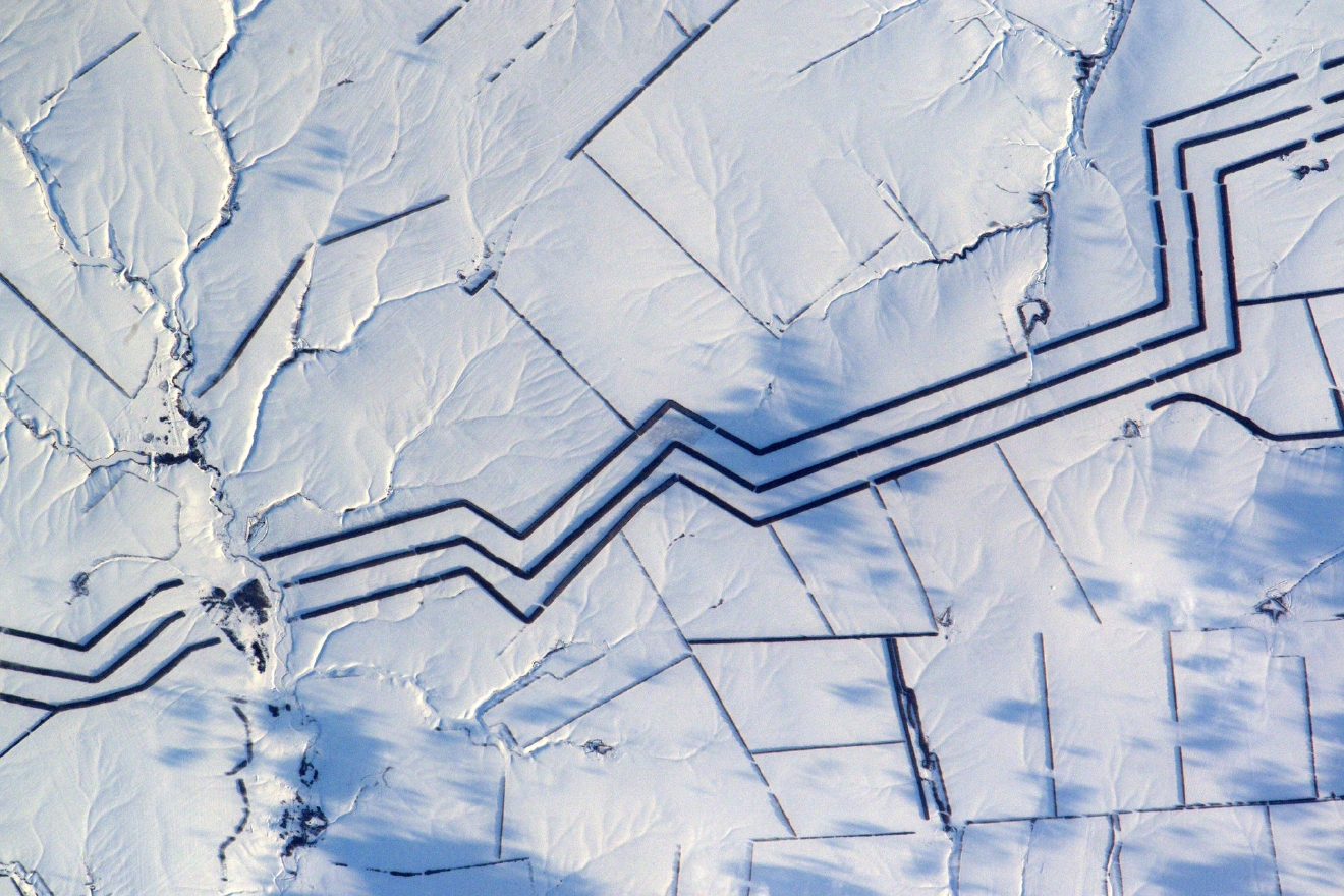 Minimalist snow art in Russia. I cannot explain these km-long parallel lines (Photo & Caption: Thomas Pesquet // NASA)