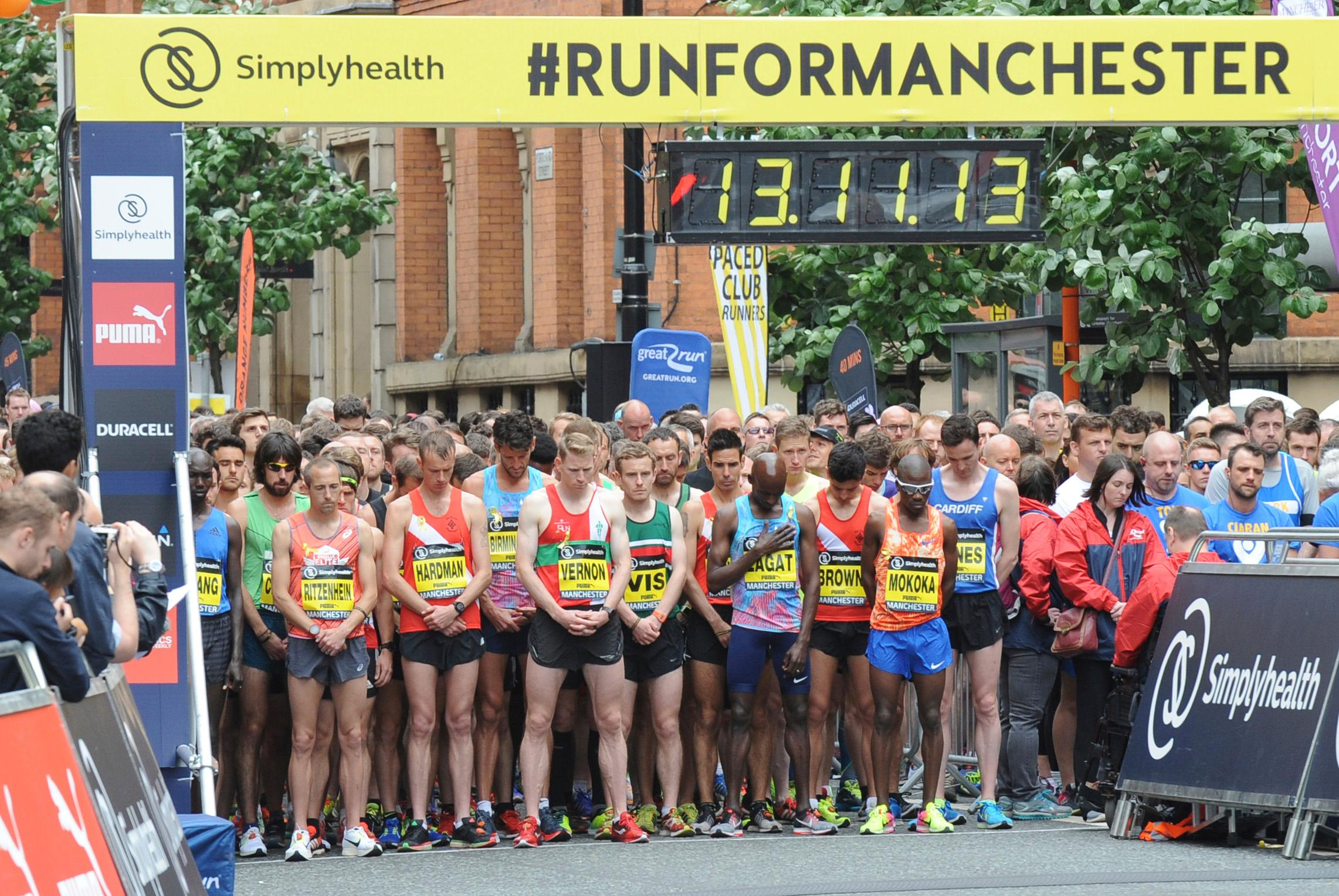 Runners observe a minutes silence before the start of the start of the Great Manchester Run in central Manchester, England Sunday May 28 2017. More than 20 people were killed in an explosion following a Ariana Grande concert at the Manchester Arena late Monday evening. (AP Photo/Rui Vieira)